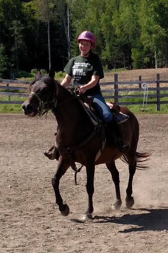 "Vivienne riding ""Lacy"" in a horse demo."