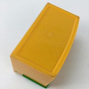 salt cellar in yellow and green bottom