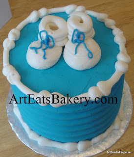 Blue butter cream baby shower cake with white booties