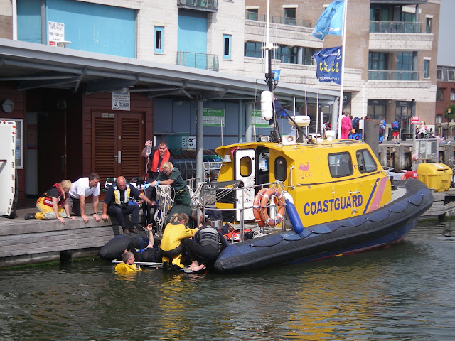 11 August 2012 - Poole volunteer crew and paramedics treat a casualty from a jet ski collision