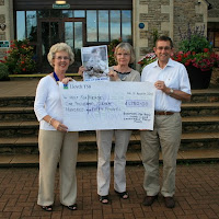 Bradford on Avon Lions Club 18th August 2010 Presentati​on of cheque as our contributi​on to Help The Heroes Appeal and in loving memory of the late David Jordan. In the picture President Judith Pam Jordan and IPP Keith Yates.