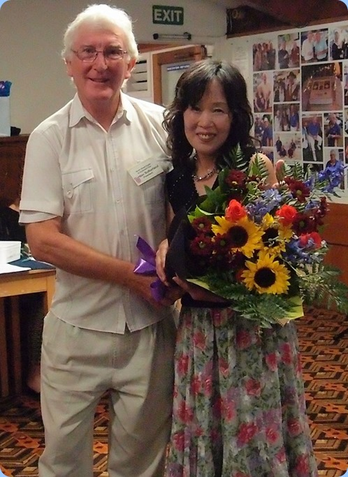 President, Gordon Sutherland, presented our guest artist from Japan, Reiko Noda, with a bouquet especially prepared by our Events Manager, Diane Lyons. Photo courtesy of Dennis Lyons.