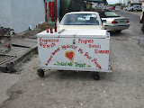And now from the other side. Almost every vendor like this has sayings painted on their cart.