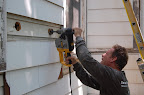 Drilling Hole into clapboard siding