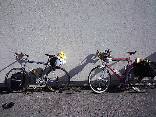 The saddle bag contained a tool kit, spare tube and Thermarest Prolite 4.  Pillow, jacket and tent are lashed on behind it.  The front bags held my sleeping bag, cookware, food, extra clothes, etc.  That's Adam's modified 80s-era Trek 520 on the right.