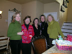 Theta alumnae find time in a busy December to attend the Theta holiday party.