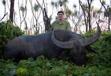 Mr Vasily Yurchenko with a big bodied buffalo taken in March in thick vegetation and vines.