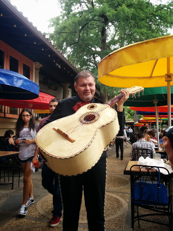 Guitarone played by street musician at San Antonio
