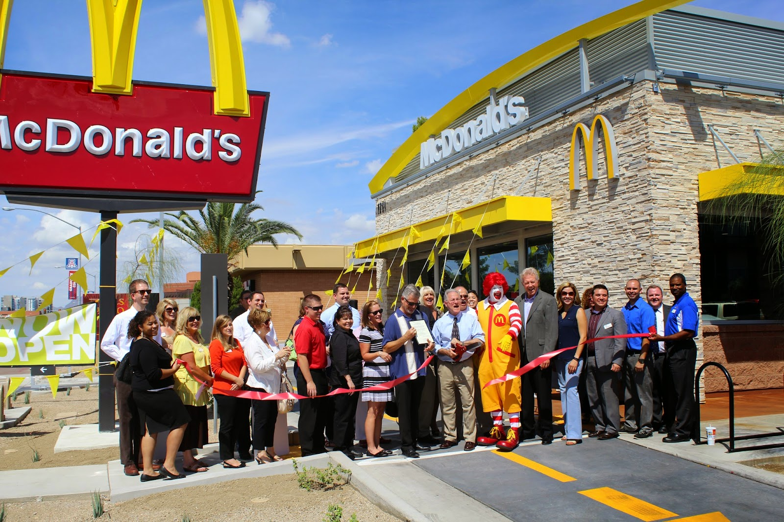 Mayor Jonathan Rothschild, Michael Varney (Tucson Metro Chamber), Tannya Gaxiola and UA Officials, Ronald McDonald and Karen and Michael Osborne (Owner/Operators) dedicate a brand new McDonald's totally rebuilt from the ground up at Speedway/Campbell near the University of Arizona.
