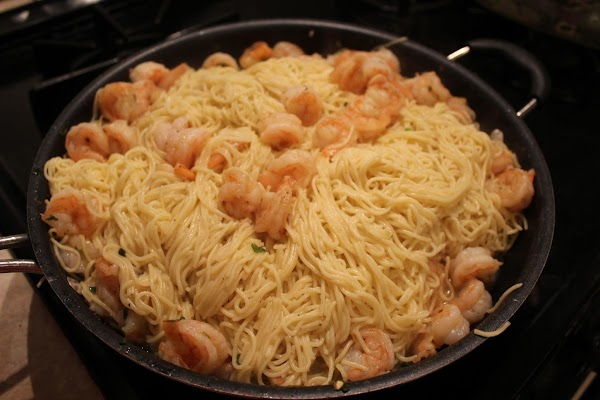 Put drained pasta into shrimp and scallions. Add extra butter, bay seasoning and salt...