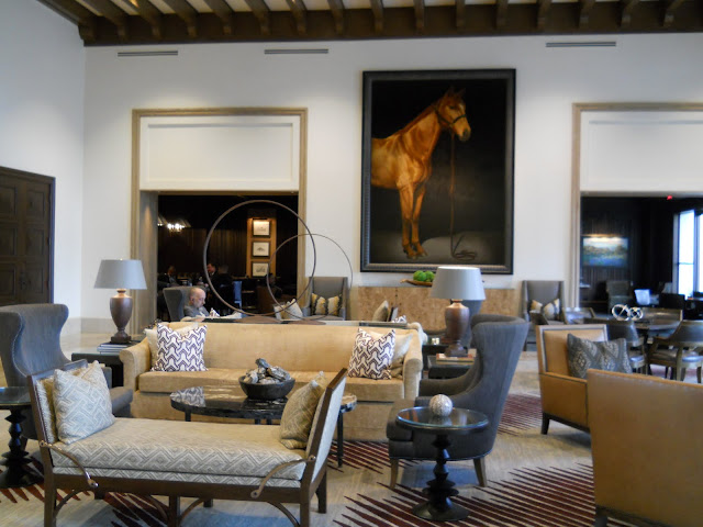 A mammoth-sized horse painting in the lobby of a Cantera Hill Country Resort