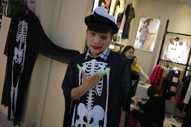 person wearing a skeleton costume at a shop in Changsha, China