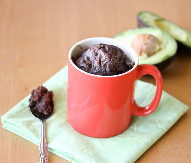 photo of an avocado mug cake with a spoon on the side