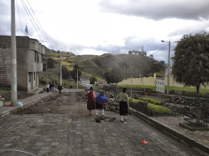 Photo: The whole town was on road duty it seemed. Some ladies with babies on their back. Roads are dug and stones laid by hand.