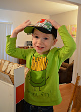 Photo: His favorite thing to pull out of the box was his hat. It fit perfectly. Whew.