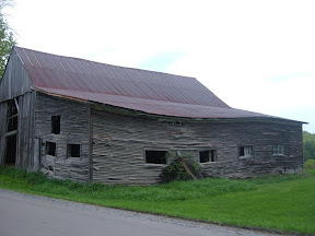 A conventionally built addition threatened to pull down this barn.