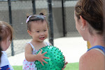 """Infants in the Parent & Child class at LePort play outside each class, learning to play """"catch"""" while discovering new types of balls to explore."""