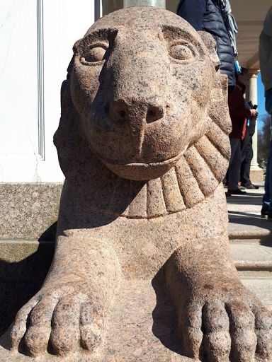 malformed lion statue literally begging to be released from its suffering