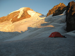 Basecamp below the Black Buttes. Summit route is through the glaciers to the saddle on the right, then up to the summit via the Roman wall.