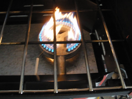 causes burner flame gas stove yellow .