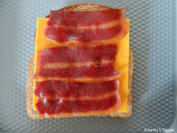 Grown up Grilled Cheese layer the cheese and add the bacon