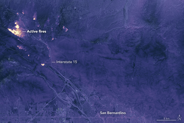 The image above shows the Blue Cut fire at 10:36 p.m. Pacific Daylight Time on 17 August 2016, as observed by Thermal Infrared Sensor (TIRS) on the Landsat 8 satellite. TIRS observes in wavelengths of 10.9 micrometers and 12.0 micrometers, showing the amount of heat (thermal energy) radiating from the fiery landscape. Cooler areas are dark, while warmer areas are bright. The thermal data was overlaid on a daytime image for added geographic detail. Photo: Joshua Stevens / NASA Earth Observatory