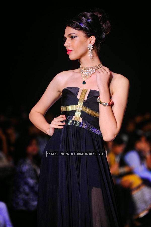 A model showcases a creation by Mahabir & KIK Jewells on Day 3 of India International Jewellery Week (IIJW), 2014, held at Grand Hyatt, in Mumbai.