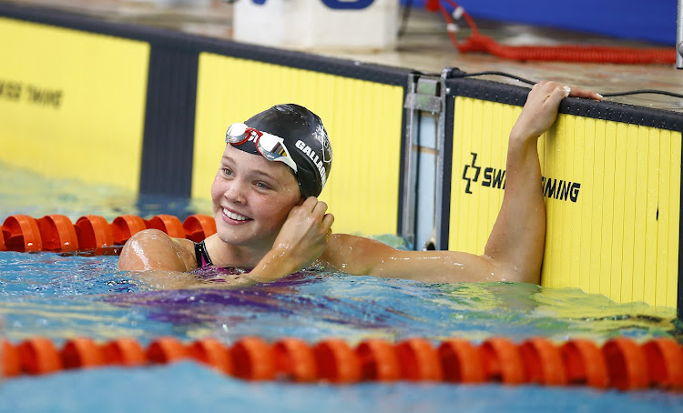 Erin Gallagher celebrates after winning the women's 100 meter freestyle during day 1 of the SA National Aquatic Championships at Kings Park Swimming Pool in Durban on April 08, 2019.
