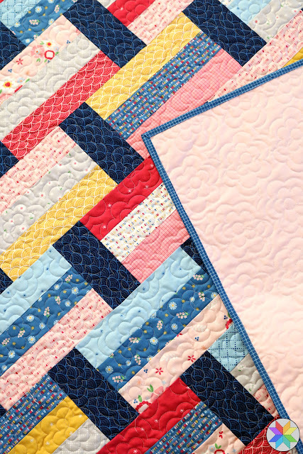 Petaline longarm quilting design found on A Bright Corner - quilt pattern is Fast Track - a great jelly roll or fat quarter quilt pattern in four sizes