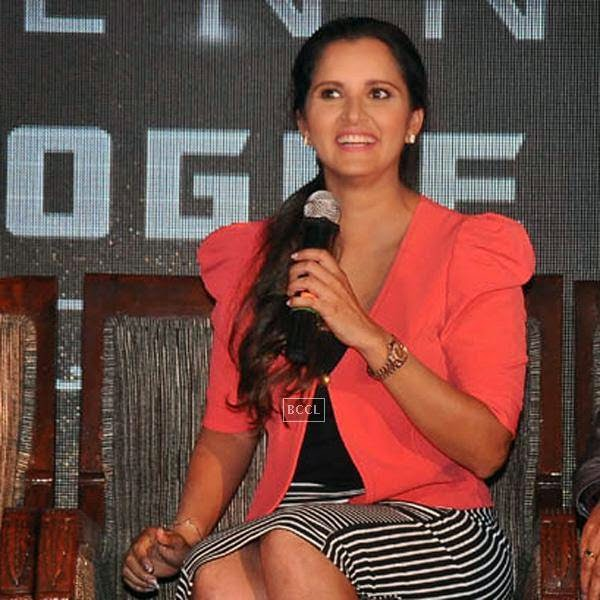 Sania Mirza shares a light moment with media during the launch of Celkon's Millennium Vogue Q455 in Mumbai, on July 25, 2014. (Pic: Viral Bhayani)