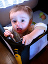 Matimu peeking up out of his crib.