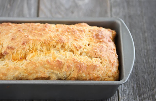 photo of a loaf of Cheese and Yogurt Quick Bread in a pan