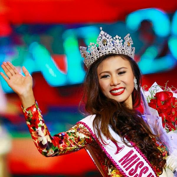 Miss Universe Myanmar 2014 Sharr Htut Eaindra waves after being crowned during the Myanmar Miss Universe competition at Myanmar National Theatre in Yangon July 26, 2014.
