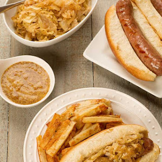 Grilled Bratwurst with Sautéed Sweet Onions and Cabbage