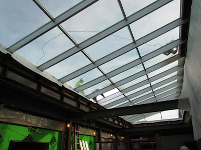 Atrium glass installation nearly complete