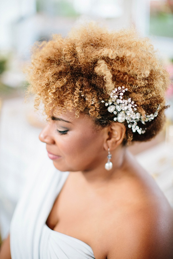 Caramel curls swept up with a bridal headpiece for black bride style ideas