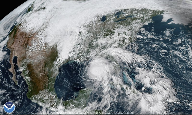This satellite image made available by NOAA shows Hurricane Michael, center, in the Gulf of Mexico on Tuesday, 9 October 2018 at 3:17 p.m. EDT. Photo: NOAA / AP