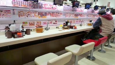 Genki Sushi in Shubuya, where you order from individual screens as you seat from a menu (there is an English menu available) and then the dishes come essentially via a sushi train directly to you. Let's not kid that this is the best sushi in Tokyo- it's just a more techie version of conveyer belt sushi that lets you tailor your order to get what you want and reduce waste for them.