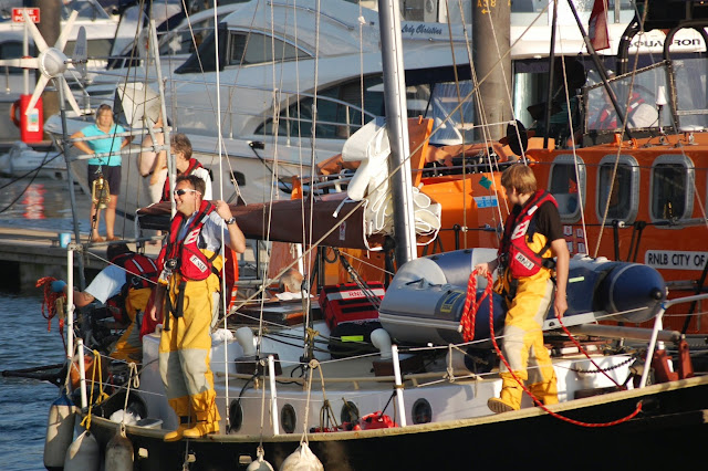 Poole ALB crew getting ready with the mooring lines. 22 August 2013 Photo credit: RNLI/Dave Riley