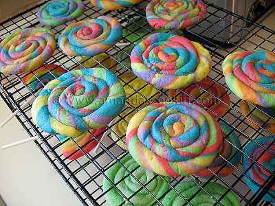 A photo of rainbow St. Patrick\'s day cookies resting on a cooling rack.
