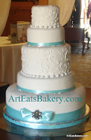 5 tier white fondant wedding cake with curlicues, edible pearls, Tiffany blue ribbons, rhinestones and brooch