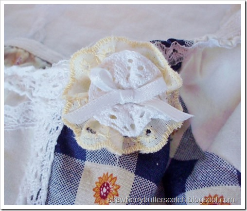 Lace rosette on a hand made dress.