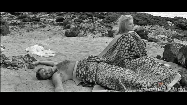 Barbara Bouchet wakes up on the beach.