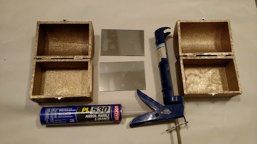 """Get your mirror, and your adhesive ready. I used the """"Loctite PL 530"""" in a caulking gun, but any adhesive that can bond to both mirror and wood should be fine. Also, some adhesives come in a squeeze tube, so you don't need a caulking gun."""