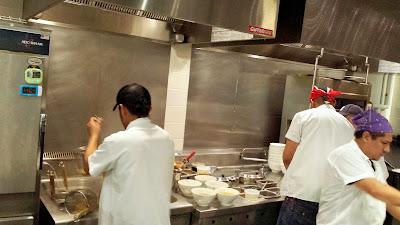 The bustling kitchen of Ivan Ramen at Gotham West Market