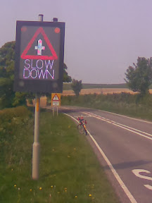 Slow Down sign on Wolds