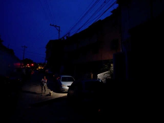 Blackout in the Venezuela capital's El Calvario neighbourhood, where people took to the streets in anger over energy rationing. The power shortages are adding to existing concerns around inflation, food shortages and crime. Photo: Fernando Llano / AP