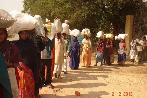 MAITRI Charitable Trust distributes monthly rations to those most in need, Bodhgaya, India, February 2012.