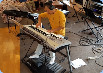 Taka Iida playing his Yamaha Electone D-Deck keyboard.