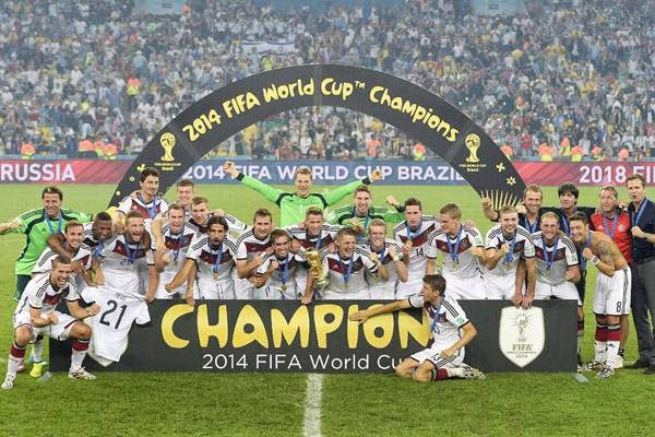German squad pose after winning the 2014 FIFA World Cup final football match between Germany and Argentina at the Maracana Stadium in Rio de Janeiro on July 13, 2014. Germany won the match 1-0.